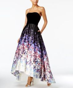 Betsy & Adam Strapless Velvet Printed High-Low Gown $339.00 The satin skirt of Betsy & Adam's high-low gown is drenched in florals, a romantic contrast to the rich velvet bodice. On-seam pockets are the essential finish.
