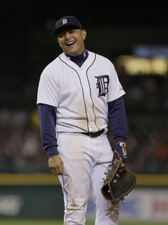 Miguel Cabrera laughs at a comment from the Cleveland Indians dugout during the eighth inning, 09/13/2014