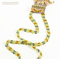 Learn how to use an eight bead daisy chain stitch to make a strap for a mini amulet bag.