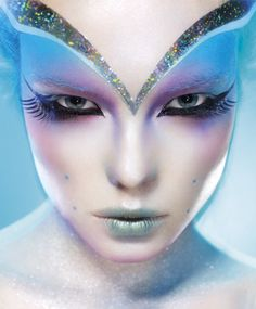 Saw a youtube tutorial of this, and she used silver glitter and aqua cream makeup for the computer effects. It looked awesome!