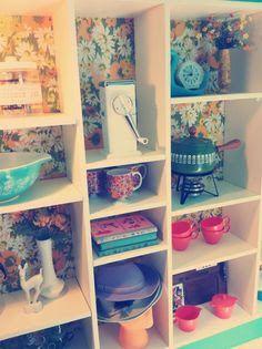 Cute boutique wallpaper shelving