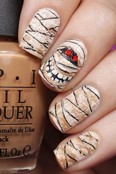 "If you're unfamiliar with nail trends and you hear the words ""coffin nails,"" what comes to mind? It's not nails with coffins drawn on them. Although, that would be a cute look for Halloween. It's long nails with a square tip, and the look has. Nail Art Halloween, Holiday Nail Art, Halloween Nail Designs, Fall Nail Art, Spooky Halloween, Halloween Ideas, Halloween 2017, Fancy Nails, Love Nails"