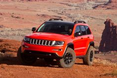 """MOAB 2013 - Jeep Grand Cherokee Trailhawk -  Characterized as the """"most extreme Grand Cherokee ever,"""" the Trailhawk's bright trim has been removed, and sports a hood and front fascia from the hot rod SRT8. It rides on Dodge Durango trailer tow rear springs with 35-inch tires, and is propelled by Jeep's new 3.0-liter turbodiesel V6."""