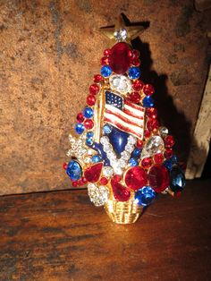 Red White and Blue Patriotic OTC Christmas  Tree Pin at Tons of Treasures in Laguna Niguel