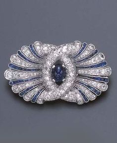 http://rubies.work/0240-ruby-rings/ AN ART DECO SAPPHIRE AND DIAMOND BROOCH Centering upon an independent cabochon sapphire, within a sculpted pavé-set diamond surround, to the scalloped frame of alternately-set calibré-cut sapphire and single and old European-cut diamond lines, mounted in platinum, circa 1925