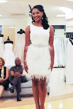 Season 9 Featured Dress: Alyne. A-line- Ivory. Silk crepe & ostrich feathers, short dress w/ feathers.  $2,900 #0122218