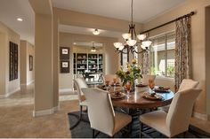 Pillars define an open dining room. The Catalina plan built by David Weekley Homes at Golf Canyon at Estrella - The Reserve. See this community in Goodyear, AZ on NewHomeSource.TV.