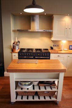 Rustic kitchen renovation with an island unit.  For a free consultation call: 0113 262 5954 http://www.redesignexperts.co.uk/