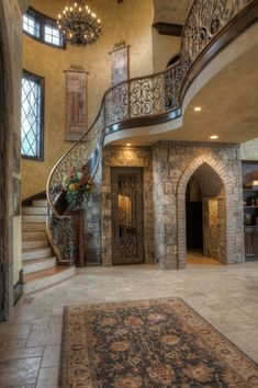 Mediterranean Entryway with travertine floors, Hanging tapestry, Cathedral ceiling, Exposed beam, specialty door, Chandelier