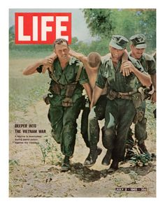 Wounded US Marine Helped to Safety by his Buddies During Fight with Viet Cong, July 2, 1965