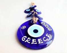 Greek Evil eye bracelet home decor charms by GreekEvilEyes on Etsy Greek Evil Eye, Evil Eye Bracelet, Love Bracelets, Blue Beads, Sell On Etsy, Couple Gifts, Valentine Day Gifts, Gifts For Him, Wallet