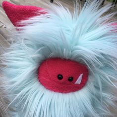 The light aqua faux fur combined with the hot pink ears and face make this Fuzzling stand out in the crowd!  Spiral is ready for adoption - who is ready to adopt a Fuzzling?