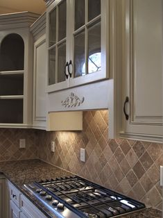 KITCHEN - formerly oak cabinets, painted off white & lightly glazed.....