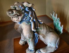 This wooden komainu was in the museum at Usa Jingu. It is a type of komainu that is no longer as common as the stone ones found at the entrances to shrines and temples. If a shrine has a Zuijinmon, an entrance gate with pairs of zuijin (guardian statues) there will often be a small wooden komainu with them.