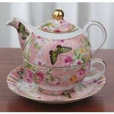 So gorgeous and pretty tea pot + cup set. Very unique and great for afternoon tea time! It has tea pot on the top and bottom part is tea cup.