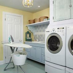 Sarah Richardson. I really love this combo of yellow grey ( or is it blue?) and white in the laundry room.