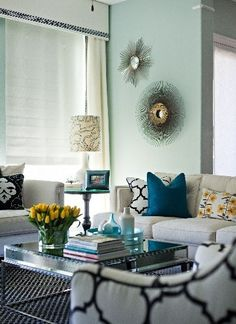 Living Room Design, like teal, black and white and yellow with a gray sofa