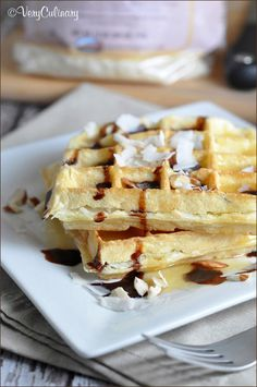 These breakfast waffles are taken to a dessert level with coconut, almonds, and chocolate syrup!