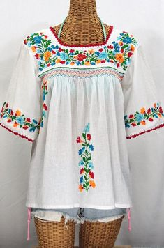 "Popular Embroidery Designs Without a doubt, our most popular peasant blouse: The ""La Marina"" Embroidered Mexican Blouse in Classic White with Fiesta Embroidery. Floral Embroidery Patterns, Mexican Embroidery, Vintage Embroidery, Blouse Patterns, Embroidery Designs, Embroidery Supplies, Mexican Blouse, Mexican Dresses, Mexican Top"