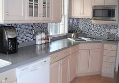 Faux back splash- removable decal sticker! Looks amazing and is a super cheap alternative for renters :)