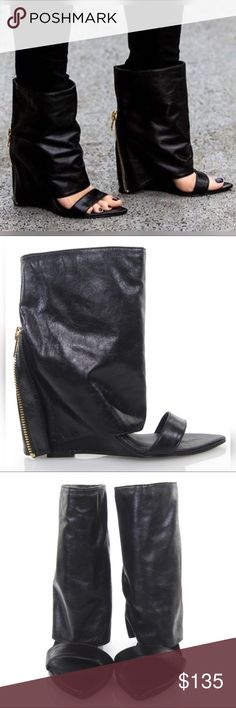"Lust For Life Black Bandit Open Toe Wedge Boots Features a 4 2/8"" (110mm) wedge heel, partially hidden by a super chic architectural leather shaft. Pull on style, gold-tone back zip embellishment (non-functional, just for show.) Open toe upper, featuring a pointed toe-bed. Total height (including heel) is approximately 10"".  High quality genuine leather upper, with an intentionally ""waxy"" texture. Synthetic sole, man-made insole. Official name is ""Bandit"", original retail is $250! Made in…"