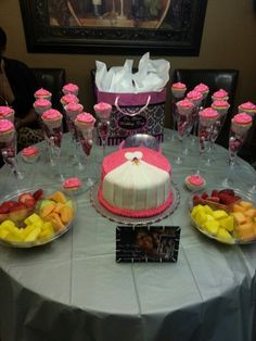 cute wedding cake, but tiered and dress going down whole cake! Wedding shower- pink & silver