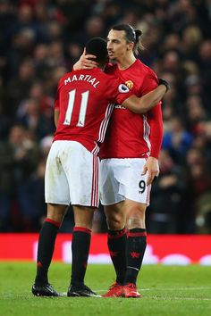 Anthony Martial of Manchester United celebrates after he scores a goal with team mate Zlatan Ibrahimovic during the Premier League match between Manchester United and Middlesbrough at Old Trafford on December 31, 2016 in Manchester, England.