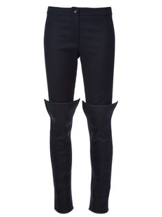 Black leather leggings from Gareth Pugh featuring a skinny leg, a concealed front zip fastening, a front button fastening, elasticated side panels and silver-tone zips at the cuffs.