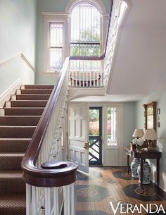 love that window on top of the steps, and the painted wood floor in the entry.