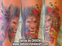 lion colorful feathers flowers leg tattoo by Chucho. Tattoo City Skin Art, Lockport, IL www.tattoocityskinart.com