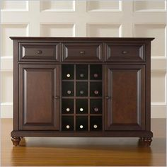 Crosley Furniture Cambridge Buffet Server / Sideboard Cabinet in Vintage Mahogany - Constructed of solid hardwood and wood veneers, this Buffet Server / Sideboard Cabinet is designed for longevity. The beautiful raised panel doors & drawers, provide the ultimate in style to dress up your home. The three deep drawers provide an abundance of storage space. Behind the two doors, you will find adjustable shelves and storage space for things that you prefer to be out of sight.