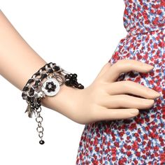 This sober and charming bracelet with metallic droppings is a must-have in every woman's jewelry collection.  Visit for buy:- http://khoobsurati.com/khoobsurati/charming-metallic-droppings-and-braided-bracelet-khoobsurati