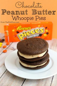 Chocolate Peanut Butter Whoopie Pies - made using a chocolate cake mix and peanut butter cream cheese frosting with Reeses Pieces. So good!