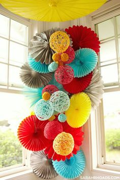 a great mix of paper and yarn balls as a decor idea.