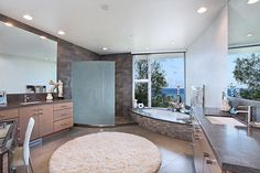I wouldn't hate to have this bathroom... Maybe in warmer tones though.