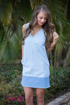 Our new Play The Game Dress is definitely what you need for versaility and style! The denim material makes it stand out and the frayed edge design gives it a trendy look! Add wedges or sandals for a finished look!