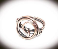 Copper wire wrapped infinity ring with triple band. Handcrafted and created using 18 gauge copper wire. Available in sizes 5 - with choice of antiqued or non tarnish finish. Free gift wrapping available upon request. Copper Rings, Copper Jewelry, Copper Wire, Wire Jewelry, Jewelry Rings, Silver Rings, Jewellery, Beaded Rings, Wire Earrings