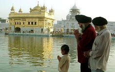 Sikhs praying near the Golden Temple (Sikh) www.blogs.reuters.com