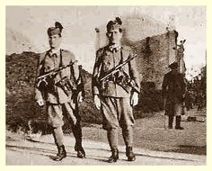 A pair of MP's patrol a street in an unknown town during Military Police, Army, Police Patrol, Defence Force, Axis Powers, Foreign Policy, Cobalt, Wwii, Art Photography