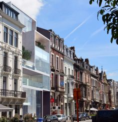 'Located in the heart of medieval Ghent city, a heartless 70? building dislocates a 19th century street. The brief: integrating 4 luxury apartments and an ex...