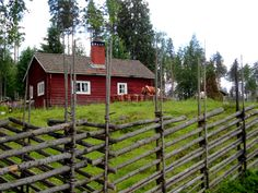 Swedish summer farm. Round pole spruce fence.