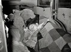 "February 1939. ""White migrant boy asleep in car. He came with his father from Houston to Edinburg, Texas."" Good night, John-Boy. Medium-format nitrate negative by Russell Lee for the Resettlement Administration. View full size."