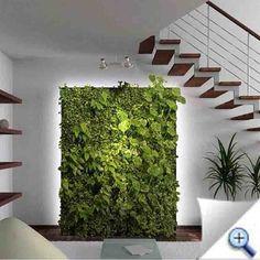 Drótkosarakból épített zöldfal egy nappaliban
