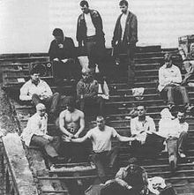 April 1, 1990 Strangeways Prison riot: The longest prison riot in Britain's history begins at Strangeways Prison in Manchester, and continues for 3 weeks and 3 days, until April 25.  Prisoners protesting on the badly damaged roof of the prison. Paul Taylor is in the centre with his arms outstretched.