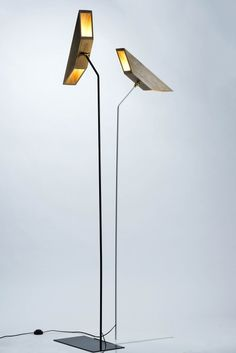 "Floor lamp The wings are used for most birds to fly in the air, The lighting fixtures series presents abstract and minimalist wings and with the lamp body allows a thin iron fixture look like it is flying in the air. ""Wings"" made of solid oak, the lighting hidden in the wood, directional lamp can illuminate up and down or left and right, the body is made of iron pipe powder paint finish. Materials: Solid oak, iron pipe Dimensions: W50 x L25 x H170"