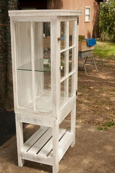 Love this multi-old window curio cabinet! Makes me want to start collecting old turquoise dishes!