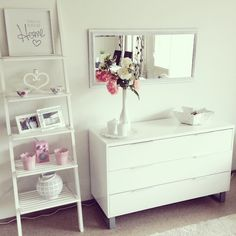 A spruced up ladder of pretty things as bedroom decor.