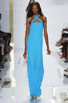 """Diane Von Furstenberg's stunning blue dress is the ideal color for those """"black tie"""" events and formal charity fundraisers in late February and early March!"""