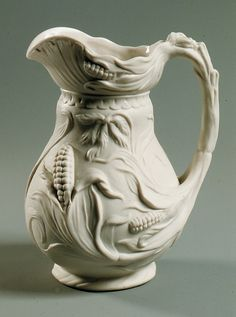 Pitcher Maker: United States Pottery Company  Date: 1850–58 Geography: New England, Bennington, Vermont, United States Culture: American Medium: Parian porcelain Dimensions: 9 x 7 x 5 3/4 in. (22.9 x 17.8 x 14.6 cm) Classification: Ceramics