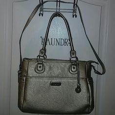 """Grace Adele Metallic Heather and Accessories Great bag and condition. Comes with long strap and hang tag. Has a black makeup bag and note pad. Bag measures 15"""" L x 9"""" H x 5.5"""" W. Faux leather grace adele Bags Shoulder Bags"""